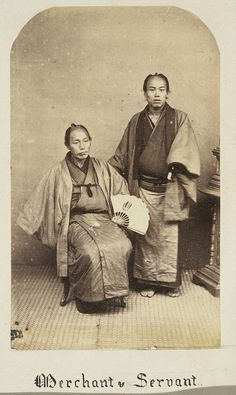 Japanese merchant and his servant, photographed between 1867 and 1869.
