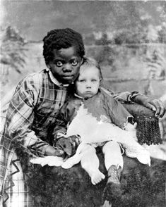 "America's Children: This 1868 photo is entitled ""Magby Peterson and his Nanny."" The little girl may have considered herself fortunate to be chisen to work as a nany rather than a field worker. However, house servants were usually isolated from their families and community. She may never have lived with here parents again after being given this job. Florida State Archives"