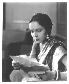 Devika Rani reading a letter in film Miya Bivi 1936