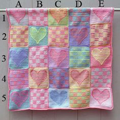 Free pattern here http://crochet.about.com/od/afghans/p/Heart-Sampler-Baby-Afghan-Free-Crochet-Pattern.htm