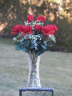 This magnificent arrangement is a very traditional display of red Real Touch flowers (ten red roses around four taller ones) set off by gypsophila (baby's breath) in a large cut crystal vase.  Just click to buy this on our Etsy store today!