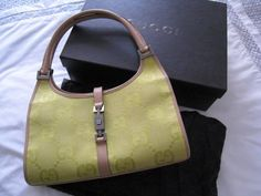 Round She Goes - Market Place - Authentic GUCCI Jackie GG Canvas and Leather Handbag