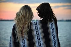 wrapped in a blanket, watching sun set or rise