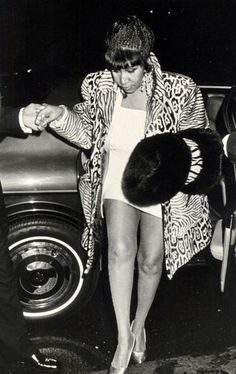 Aretha Franklin loves wearing fur and animal prints. The 18-time Grammy winner throws a leopard and zebra print coat over a white mini-dress and adds mink cuffs for a decorative touch.