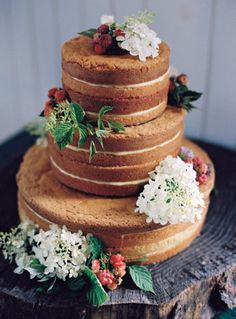 In the neighborhood of wedding cakes, there's a new kid on the block. The naked, sans-icing and unfrosted wedding cake is fresh, different, and the perfect complement for a wedding, especially the rustic summery ones. on http://www.bridestory.com/blog/bare-it-all-these-naked-wedding-cakes-are-our-new-favorites
