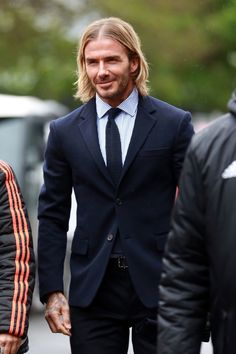 The soccer star has spent his career blazing a trail for the well-coiffed man with a weakness for statement hair. David Beckham Long Hair, David Beckham Suit, Beckham Hair, David Beckham Style, Victoria And David, Bend It Like Beckham, Hairstyles Haircuts, Haircuts For Men, Blonde Bobs