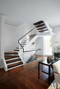 Find home décor inspiration at Architectural Digest. Everything you'll need to design each and every room in your house, from the kitchen to the master suite. Open Stairs, Glass Stairs, Wood Stairs, House Stairs, Carpet Stairs, Basement Stairs, Modern Basement, Wood Walls, Grey Walls