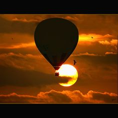 *Hot air balloon descending in the sunset.