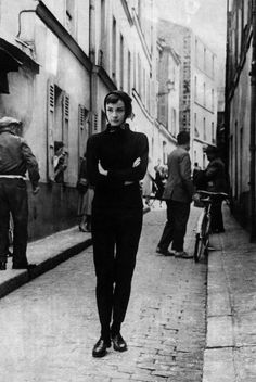 "The actress Audrey Hepburn photographed in Montmartre, the famous bohemian neighborhood of Paris (France), during a break in the filming of ""Funny Face"", in May 1956. Audrey was wearing: Pants: Rose Bertin (of black twill cotton, of the collection for the Autumn/Winter 1955/56). Loafers: Tod's."