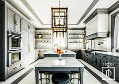 Classic gray and calacatta marble kitchen with simply elegant cabinetry, hardware, and brass lantern pendants all custom designed. Designed by Joseph Danielsen. #interior #design