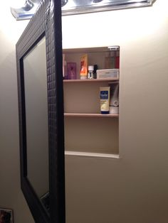Diy Medicine Cabinet. Removed old medicine cabinet from the wall, patched and painted the hole then mounted a new framed mirror with a piano hinge and installed shelves and magnet to keep it shut! I love it!