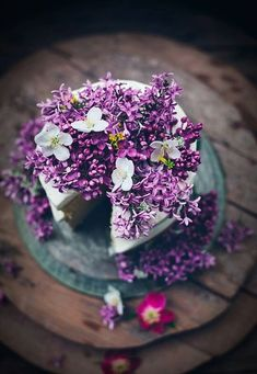 Cake love: a spring wedding cake covered in edible lilac flowers and dainty blossom