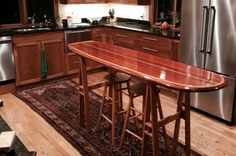 cool kitchen island with the wooden surfboard top; unique nautical kitchen design