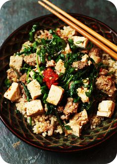 This is such an awesome healthy food/comfort food dinner.  Kale Mabo Tofu made in a rich savory broth over brown rice. YUM!