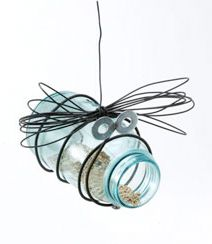 A hanging bird feeder bug made from an old mason jar and bailing wire.