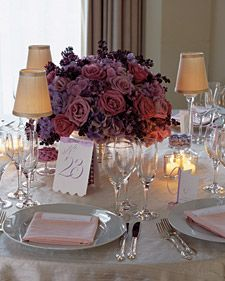 Tables are set with arrangements of hydrangeas and roses in varying combinations of green and white, pink, or lavender, as here. Supper-club lamps add old-fashioned flair, as do the dance cards at each woman's place. Inside, men can write their names by the songs they wish to claim for dances.