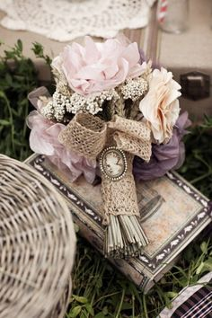 Victorian bouquet with burlap and cameo. I want to incorporate burlap in with my girls and my flowers ribbon around the stems:)
