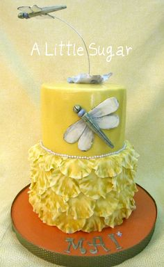 https://flic.kr/p/9riYXM   dragonfly cake   I love pretty cakes and this was my idea of just that! Dragonflies are gumpaste, painted with lustre dusts. RV cake and chocolate mud with fudge filling... the orange-y board was really a more vibrant color in real life...pic looks terra cotta but it wasn't.    A Little Sugar on Facebook