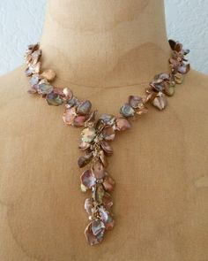 "Shimmering Copper Colored Keishi Fresh Water Pearls, Top Drilled Pearl, Swarovski Crystal ""Y"" Necklace. $90.00, via Etsy."