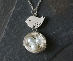 Lovely Bird and Nest necklacePearl by tyrahandmadejewelry on Etsy, $30.50