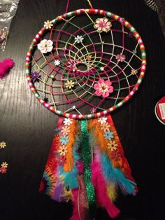 Bright and flowery handmade custom dream catcher. Hoop is made out of quality craft yarn with flower and rhinestone accents. Dream Catchers, Flower Power, Native American, Feather, Crochet, Diy, Crafts, Vintage, Decor