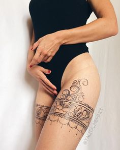 No photo description available. Thigh Garter Tattoo, Lace Thigh Tattoos, Upper Thigh Tattoos, Leg Tattoos Women, Ribbon Tattoos, Lace Garter Tattoos, Thigh Henna, Rosary Tattoos, Bracelet Tattoos