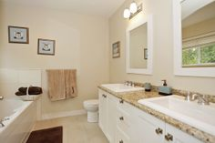 Relax in this high end ensuite bathroom featuring a soaker tub