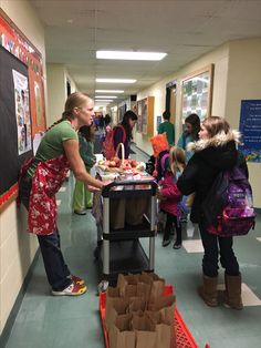 Jenny V. greets students at Monkton school with a smile and a breakfast bag every day - Starting each day smart with school breakfast!