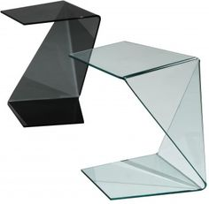 Just like the art form that inspired its name, the Origami table group defies nature by creating bent glass forms that shape in multiple directions to puzzle the observer as to how the could possibly have been created. The beauty of the design is that it can be used in the home either as a #cocktailtable or end table and can be moved around to serve family and friends in the most user friendly fashion.