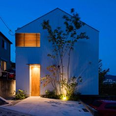 This Japanese house has a central void that stretches all the way up to its pitched roof.