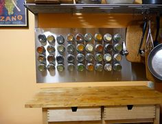 This wall-mounted stainless steel board + a little handy work creates a really cool spice rack! I never know how to organize my spices and in a small space this is easy, affordable, and convenient!