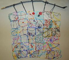 Beautiful. It sure looks like they used Twisteez wire... a quilt mural made from colorful craft wire.