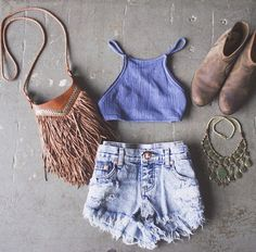 Denim shorts, periwinkle crop top, gold statement necklace, brown booties, brown fringe purse