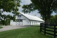 Former Woodlyn Farm - now a division of Dixiana. True turn-key farm with 100 stalls, older stone main residence with tons of character, newer 4,445 SF manager's home plus 2 employee houses. Office with attached shop, 50' x 100' hay/equipment building, two 6-horse exercisers, 4 round pens, 6 acre lake. 3 gated entrances. Proven, productive soils.  $5,324,000. Round Pen, Entrance Gates, Stalls, Division, Farms, Acre, Pens, Houses, Outdoor Structures