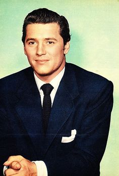 Gordon Macrae.  Without hesitation, one of my favorite entertainers and I think one of the most talented, handsome, and enchanting men to ever live.  No other actor can touch his performance as Curly :)