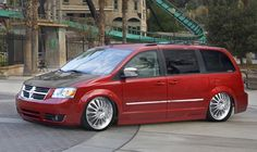 Dodge Caravan. Dropped. Rims. Carbon fibre hood. May be Photoshopped.