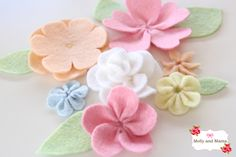 Felt Flower Blooms by Molly and Mama.  I love the colors of these flowers. They're beautiful without the embellishments and are a work of Art.