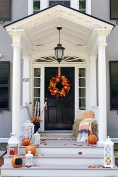 Front porch decor inspiration to carry you though Thanksgiving! A wreath, lanterns, pumpkins, hay and a throw are on our list for having the best porch on the block!