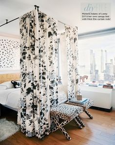 .curtain rods hung from the ceiling floral fabric with velvet lining = DIY canopy bed, print above bed & animal print benches at end of bed. - sublime-decor.com