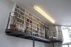 For an extra-high ceiling this is a genius approach to a mezzanine!