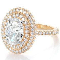 Stunning double halo design from Knox Jewelers. This regal micro pave design features a 2.00ct oval center stone in 14k yellow gold. This diamond engagement ring can be customized to your preference of center stone and metal type.