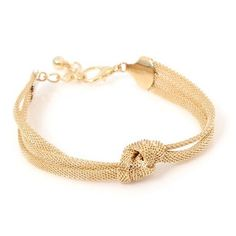 When layering on a stack of bracelets look for a wide range of styles and textures.  This Eugenie Knot Bracelet - $28 will look great paired...
