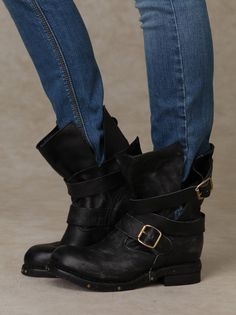 Brit Boot | Distressed leather slouch boot with wrapped buckle straps. Stud detailing around outer sole. Padded footbed. Fully rubber sole.