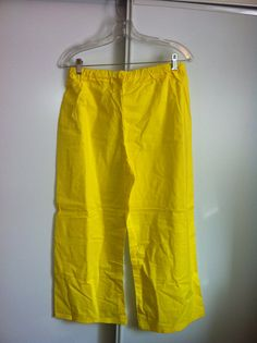 """This is a basic pair of peasant pants. It is a perfect item for a Men's Peasant Renaissance Faire outfit. It is made of 100% cotton, Yellow in color. It has an elastic waist. It is size Medium. The elastic waist measures 29"""" at rest. It is 35"""" in length.     These pants can also be made in other colors, and is available is sizes Small through XLarge, with a custom length."""