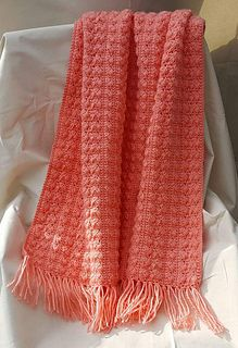 This is a written crochet pattern for a small throw. Perfect as a keepsake baby blanket or lapghan. Or increase the pattern, using the included instructions, to make a full size afghan or bedspread.