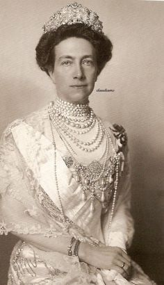 Queen Victoria of Sweden--looks like that heavy diamond crown is giving her a bit of a headache. It's not easy being so rich, you know. But I bet I'd be fantastic at it!