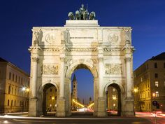 """The Arch of Victory, Munich, Germany - The Bavarian army, which was decisively involved in the victory against Napoleon, is dignified therewith. The chariot of Bavaria on the top of the arch is pulled by four lions. The inscription """"Dem Sieg geweiht, vom Krieg zerstört, zum Frieden mahnend"""" (Dedicated to the victory, destroyed by war, to remind the peace) was placed there after World War II."""