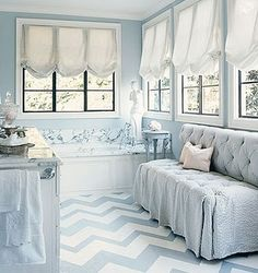 Gorgeous blue and white bathroom retreat by Mary McDonald. Love the chevron painted floors, girly relaxed roman shades, and tufted big seersucker settee with draped edges. Floor Design, House Design, Design Room, Painted Hardwood Floors, Balloon Shades, Chevron Floor, Blue Chevron, Blue Floor, Chevron Tile