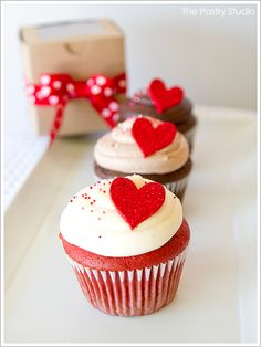 cute presentation (brown craft box tied with a Valentine bow) for that glitter topped heart cupcake...