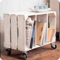Wooden Crate Organization.  Add dividers   and #casters to a #vintage wooden crate and it becomes a perfect space to store magazines, books, etc.